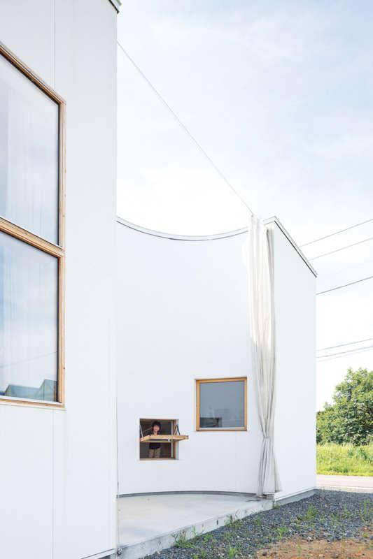 半円形の外壁が、程よいプライベート空間をつくっている
