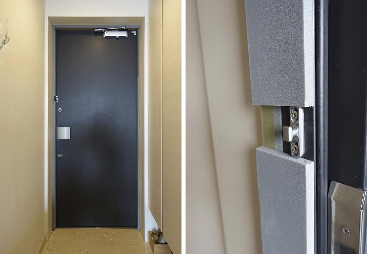 写真6 玄関ドアの様子<br>玄関ドアの内側スチール枠に断熱板を張り付けた
