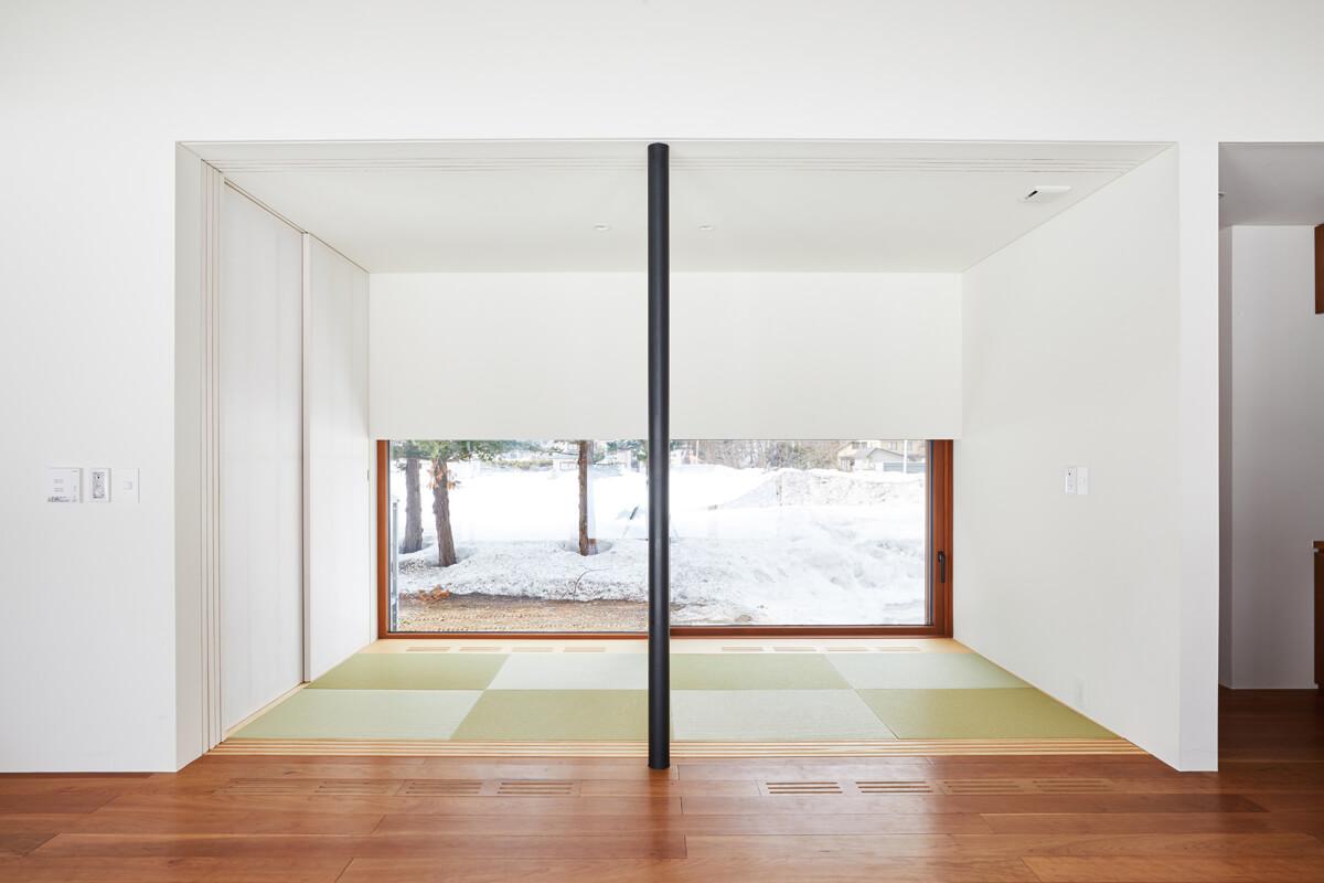 客間を兼ねた和室は、リビングと一体的に利用できる可変性を持たせたつくりに