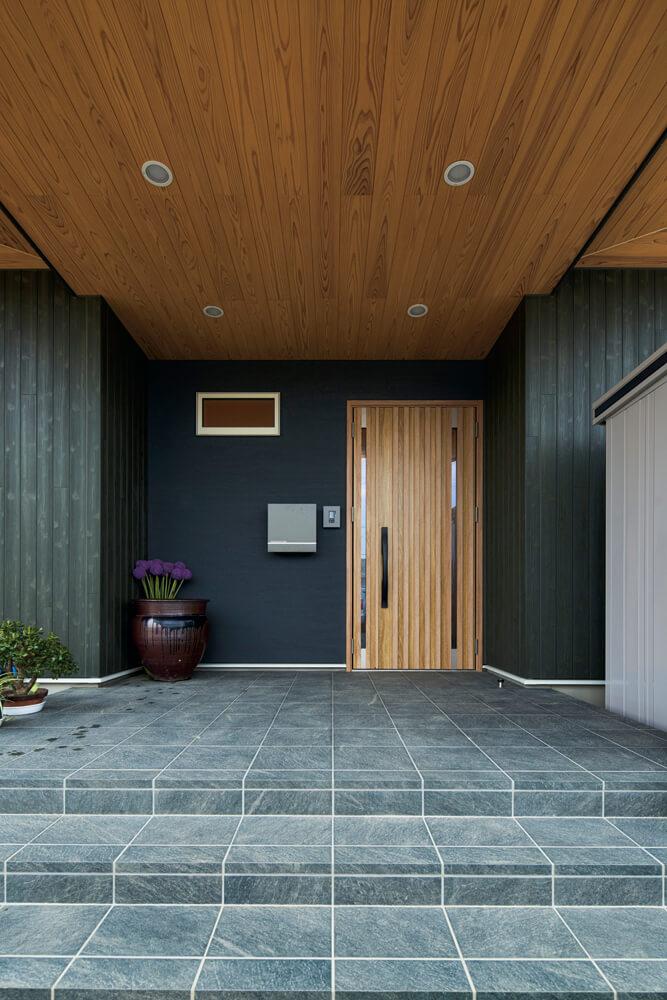 外壁は主にサイディング張りだが、玄関まわりには同系色の塗り壁を施し、豊かな表情をプラス