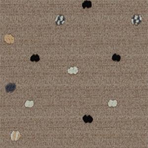 水玉模様。この生地はドットの部分を織り糸で膨らませたふぞろいさが楽しい